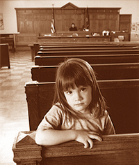 Picture of a little girl sitting in a room in court.
