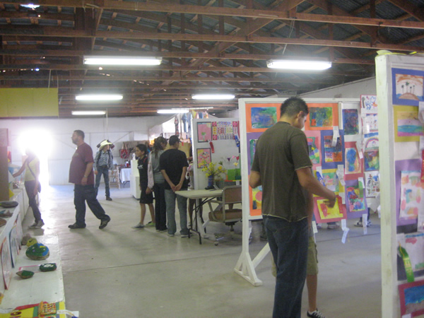 People walk around the building, taking in all the artwork.