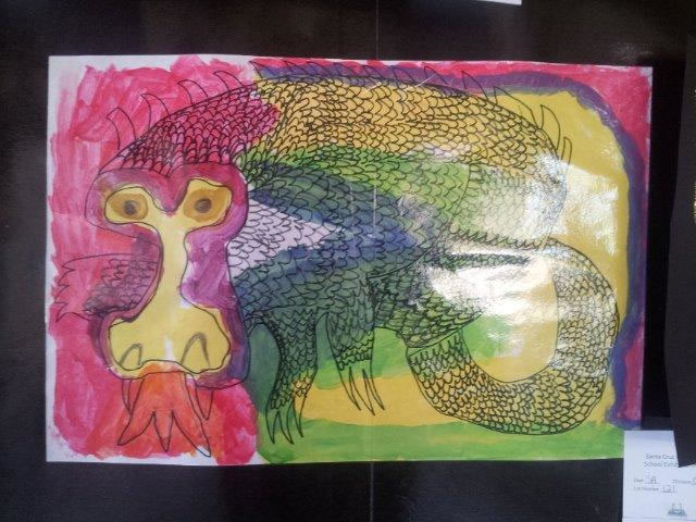 Student drawing of a scaled creature, using all the colors of the rainbow.