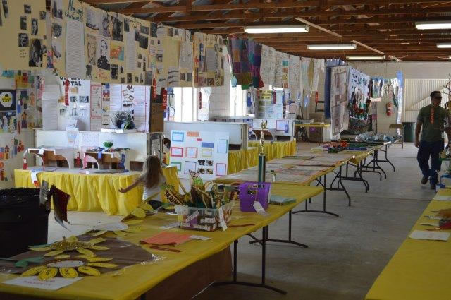 Art displays sitting on the bright table cloths.