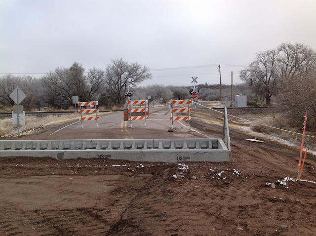 Constructing the rail road crossing and cattle guard.