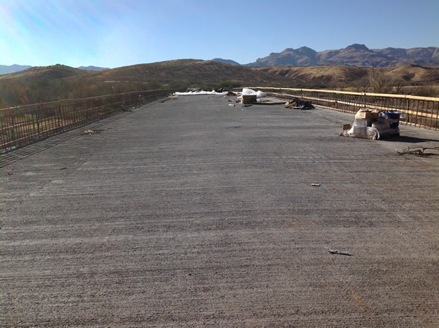 Concrete freshly laid on the top of the bridge